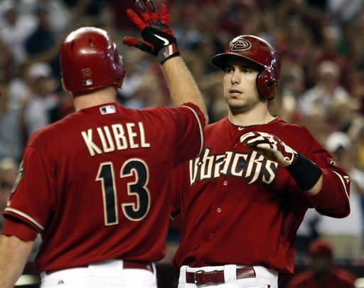 Arizona Diamondbacks first baseman Paul Goldschmidt, right, celebrates with Jason Kubel after hitting a three-run home run against the Los Angeles Dodgers in the fifth inning during a baseball game on Sunday, July 8, 2012, in Phoenix. (AP Photo/Rick Scuteri)