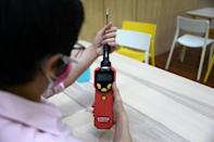 Chadin hopes the device might be rolled out as an affordable alternative to more expensive swab tests (AFP/Lillian SUWANRUMPHA)