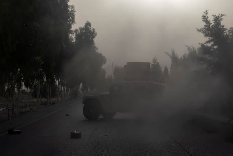 A humvee belonging Afghan Special Forces is seen destroyed during heavy clashes with Taliban during the rescue mission of a police officer besieged at a check post, in Kandahar province