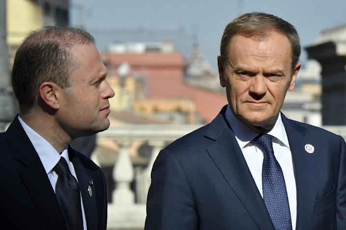 EU President Donald Tusk (R) speaks with Malta's prime minister Joseph Muscat ahead of a special summit of EU leaders to mark the 60th anniversary of the bloc's founding Treaty of Rome, on March 25, 2017 at Rome's Piazza del Campidoglio (AFP Photo/Andreas SOLARO)