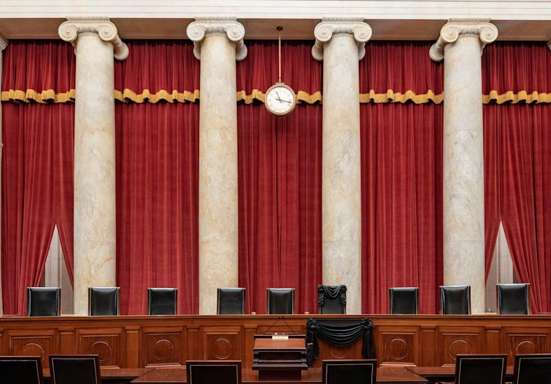 The Supreme Court bench draped for the death of Justice Ruth Bader Ginsburg on Sept. 19, 2020.