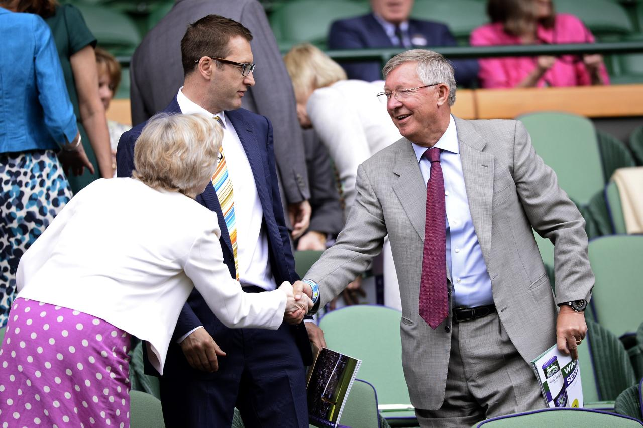 LONDON, ENGLAND - JULY 03: Sir Alex Ferguson arrives to take his seat in the Royal Box on Centre Court before the Gentlemen's Singles quarter-final match between David Ferrer of Spain and Juan Martin Del Potro of Argentina on day nine of the Wimbledon Lawn Tennis Championships at the All England Lawn Tennis and Croquet Club at Wimbledon on July 3, 2013 in London, England. (Photo by Dennis Grombkowski/Getty Images)