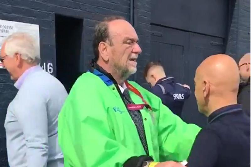 Security checks: the steward can be seen barely brushing fans as he frisks them: Twitter