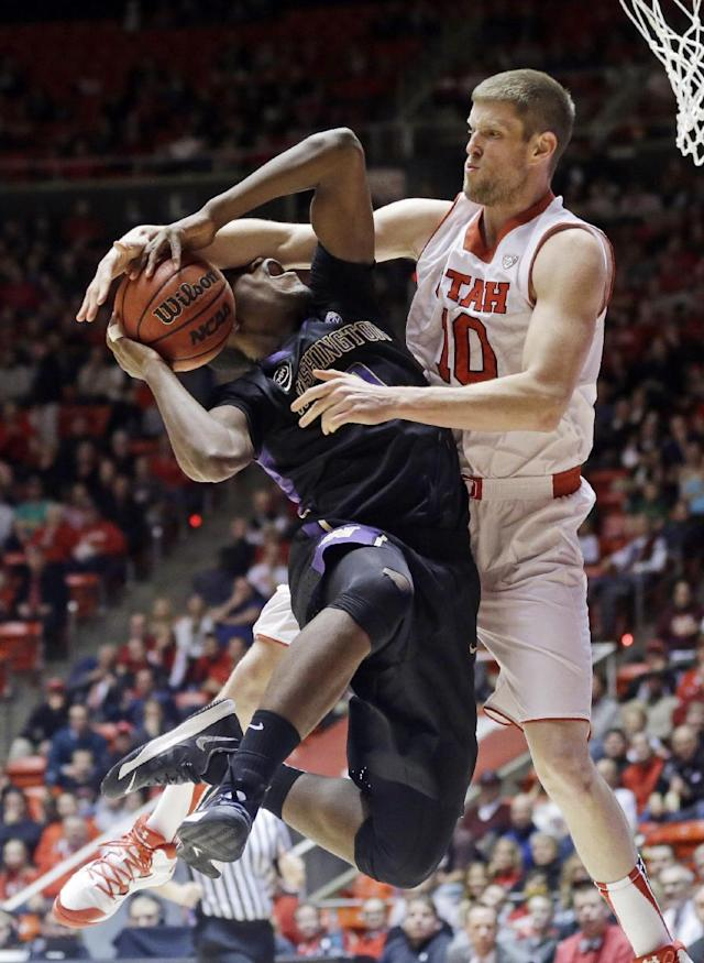 Utah's Renan Lenz (10) fouls Washington's Mike Anderson, left, as he goes to the basket in the first half of an NCAA college basketball game Thursday, Feb. 6, 2014, in Salt Lake City. (AP Photo/Rick Bowmer)