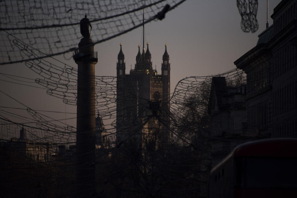 The Victoria Tower is seen behind the Christmas decorations in Regent Street St James's, in London, Saturday, Jan. 9, 2021, during England's third national lockdown to curb the spread of coronavirus. (AP Photo/Alberto Pezzali)