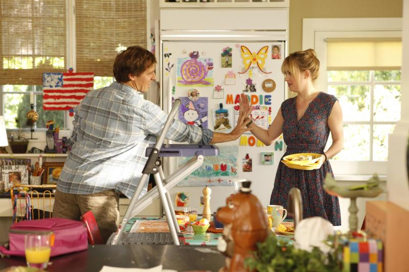 """This image released by Fox shows Nat Faxon, left, as Ben, and Dakota Johnson, as Kate, in a scene from """"Ben and Kate."""" It's the tale of a freewheeling brother, Ben, who comes back into the life of his single-mother younger sister, Kate, to serve both as a surrogate dad and continue in his lifelong role as a mischievous child. The show is based on the relationship of its creator, Dana Fox, with her own big brother, whose name is Ben. (AP Photo/Fox, Beth Dubber)"""