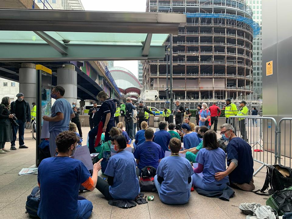 Protesters seen outside a DLR station in east London (The Independent)