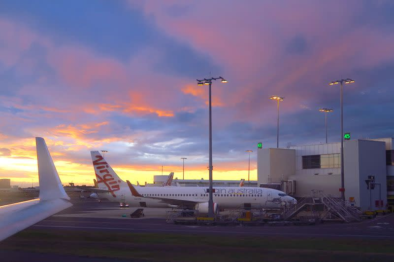 FILE PHOTO: A Boeing 737-800 aircraft from Australia's second-largest airline, Virgin Australia, is seen on the tarmac at the domestic terminal of Sydney Airport