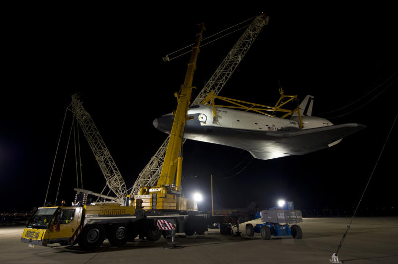 In this photo provided by NASA, the space shuttle Enterprise is lifted in preparation for its mating to the NASA 747 Shuttle Carrier Aircraft for transport to New York at Washington Dulles International Airport, Friday, April 20, 2012, in Sterling, Va. Enterprise is expected to go on display at the Intrepid Sea Air and Space Museum in New York. (AP Photo/NASA, Bill Ingalls)