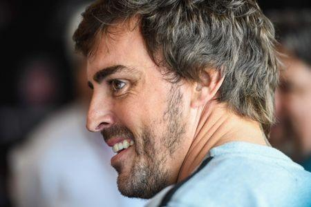 Apr 23, 2017; Birmingham, AL, USA; Fernando Alonso arrives for a press conference prior to the Honda Indy Grand Prix of Alabama at Barber Motorsports Park. Mandatory Credit: Shanna Lockwood-USA TODAY Sports