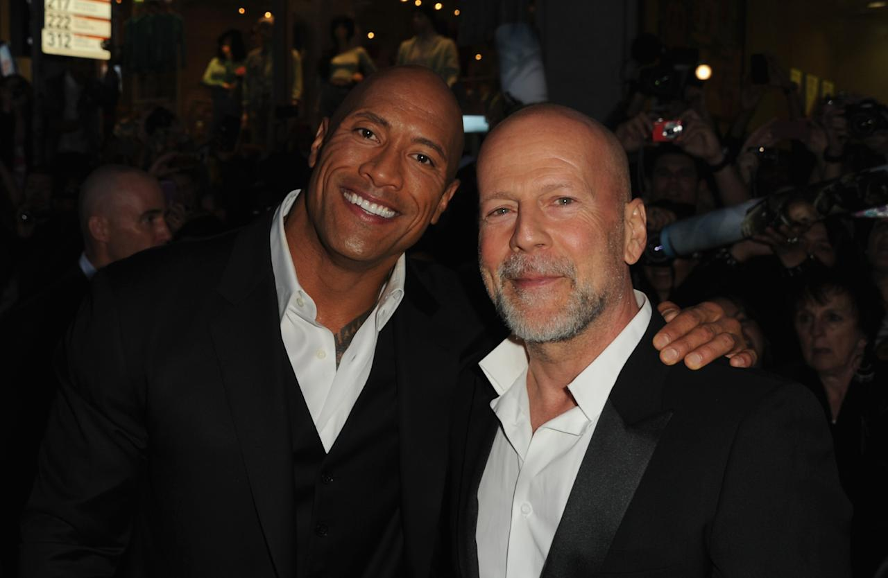 """HOLLYWOOD, CA - MARCH 28: Actors Dwayne Johnson and Bruce Willis attend the premiere of Paramount Pictures' """"G.I. Joe:Retaliation"""" at TCL Chinese Theatre on March 28, 2013 in Hollywood, California.  (Photo by Kevin Winter/Getty Images)"""