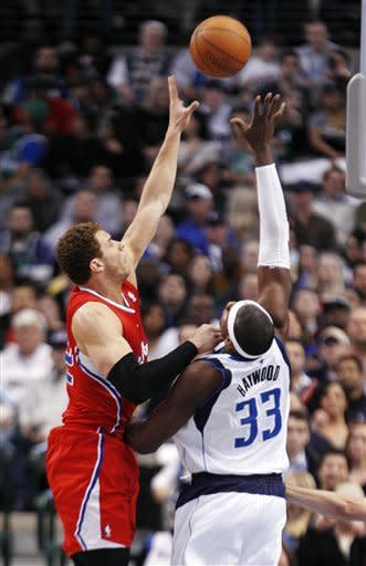 Los Angeles Clippers power forward Blake Griffin (32) shoots over Dallas Mavericks center Brendan Haywood (33) during the first half of an NBA basketball game in Dallas, Monday, Feb. 13, 2012. (AP Photo/LM Otero)