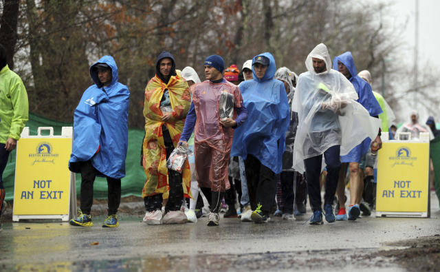 Runners arrive at the athletes village prior to the start of the123rd Boston Marathon on Monday, April 15, 2019, in Hopkinton, Mass. (AP Photo/Stew Milne)