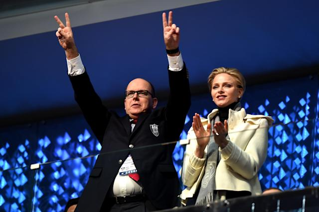 SOCHI, RUSSIA - FEBRUARY 07: Prince Albert II of Monaco and Princess Charlene of Monaco enjoy the atmosphere during the Opening Ceremony of the Sochi 2014 Winter Olympics at Fisht Olympic Stadium on February 7, 2014 in Sochi, Russia. (Photo by Pascal Le Segretain/Getty Images)