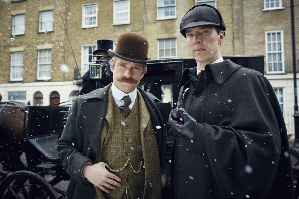 "In this image released by PBS, Martin Freeman, left, and Benedict Cumberbatch appear in MASTERPIECE's ""Sherlock: The Abominable Bride."" PBS' ""Masterpiece,"" the drama and mystery showcase, marks its 50th anniversary Sunday. (Robert Viglasky/Hartswood Films and BBC Wales for BBC One and MASTERPIECE/PBS via AP)"