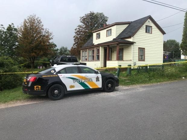 Police cordoned off a house in North Sydney, on Sept. 3, 2020, in connection with the death of a man, 60. (Brent Kelloway/CBC - image credit)