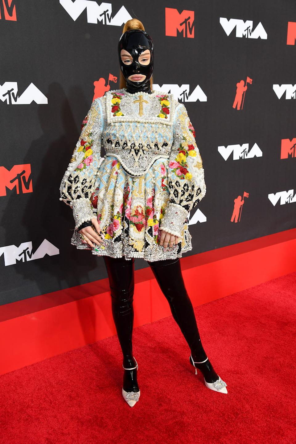 Kim Petras in latex mask at the 2021 MTV Video Music Awards