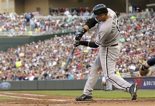 Chicago White Sox's A.J. Pierzynski (12) hits a single against Minnesota Twins starting pitcher Nick Blackburn during the second inning of a baseball game, Tuesday, July 31, 2012, in Minneapolis. (AP Photo/Genevieve Ross)