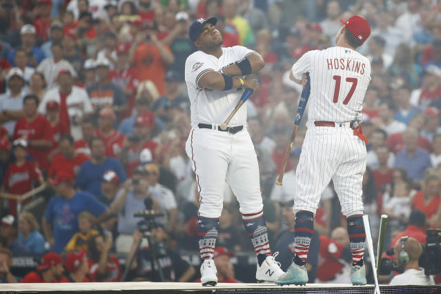 Milwaukee Brewers Jess Aguilar, left, and Philadelphia Phillies Rhys Hoskins (17) face off before the MLB Home Run Derby, at Nationals Park, Monday, July 16, 2018 in Washington. The 89th MLB baseball All-Star Game will be played Tuesday. (AP Photo/Patrick Semansky)