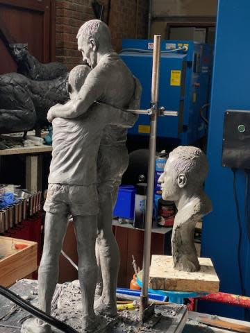 A model of the proposed statue of Rob Burrow and Kevin Sinfield embracing