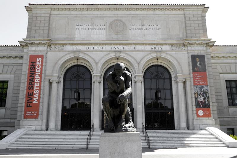 """Auguste Rodin's sculpture """"The Thinker"""" is shown outside The Detroit Institute of Arts in Detroit, Tuesday, July 10, 2012. The Detroit Institute of Arts is working to persuade voters to authorize a tax to support the cultural institution, promising free admission and expanded programing if it passes while raising the possibility that the museum would be a shadow of its current self if it's rejected.(AP Photo/Paul Sancya)"""