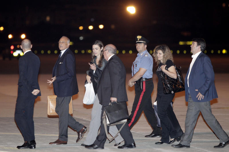 Australian lawyer Melinda Taylor, third from left, holding a white bag, prepares to board a plane to Rotterdam after disembarking from Tripoli at Rome's Ciampino military airport after being released from Libya, Monday, July 2, 2012. Taylor is one of the four International Criminal Court staffers who had been held for nearly four weeks on allegations that they shared documents that could harm national security with Moammar Gadhafi's imprisoned son Seif al-Islam Gadhafi. (AP Photo/Riccardo De Luca)