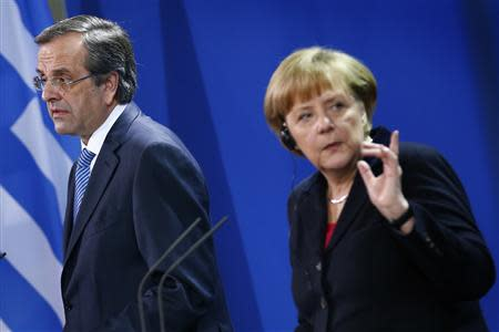 German Chancellor Angela Merkel and Greece's Prime Minister Antonis Samaras attend a news conference after talks at the Chancellery in Berlin, November 22, 2013. REUTERS/Thomas Peter