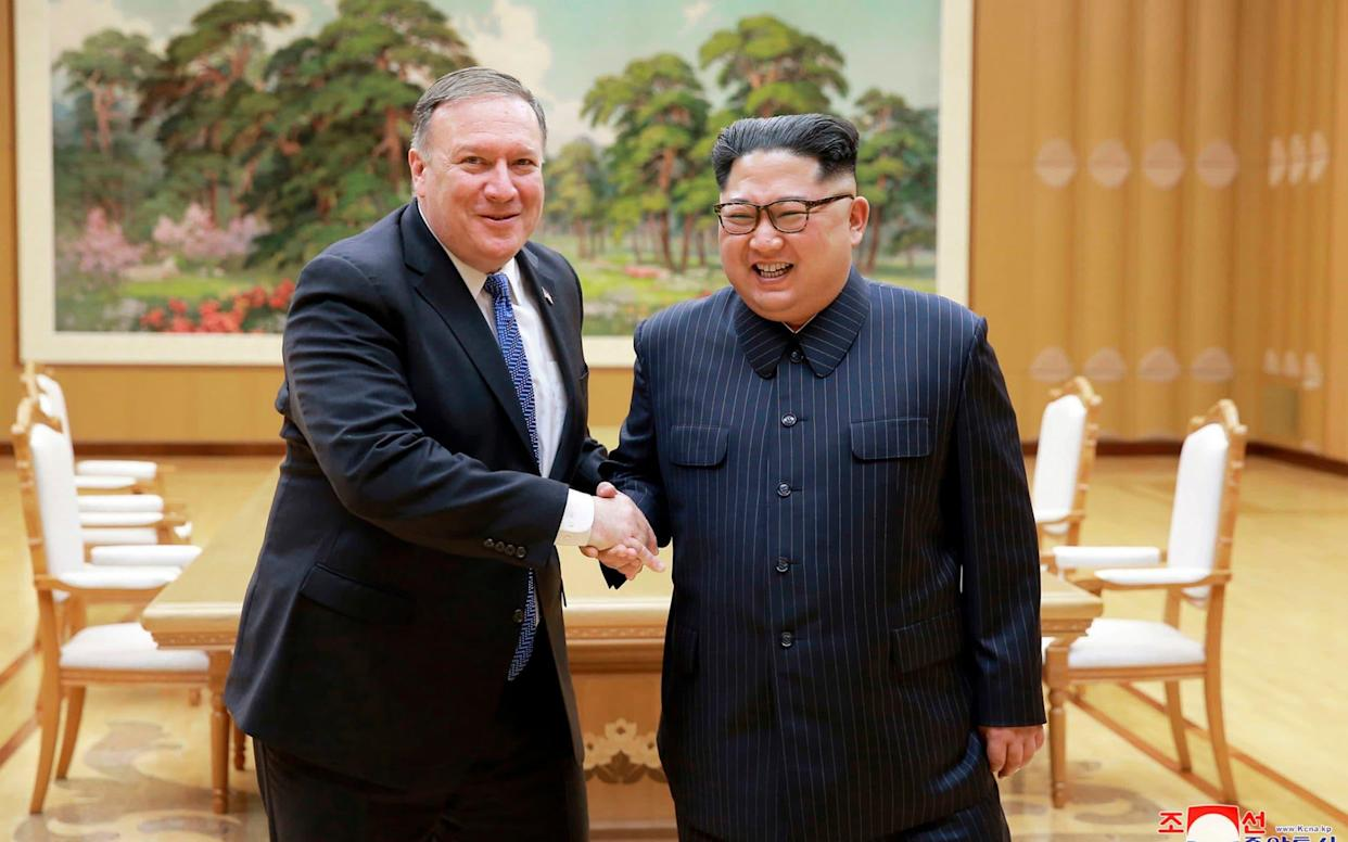 Secretary of State Mike Pompeo, left, shakes hands with Kim Jong-un in Pyongyang in May - KCNA via KNS