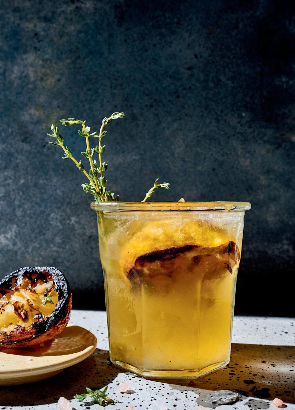 """For a drink that goes with anything, turn to this vodka-thyme-lemon concoction (a true pairs-with-anything triumvirate). The lemon halves are grilled, giving the drink a smoky edge and a touch of <a href=""""https://www.epicurious.com/expert-advice/burn-your-dinner-on-purpose-article?mbid=synd_yahoo_rss"""" rel=""""nofollow noopener"""" target=""""_blank"""" data-ylk=""""slk:balancing bitterness"""" class=""""link rapid-noclick-resp"""">balancing bitterness</a>. <a href=""""https://www.epicurious.com/recipes/food/views/thyme-out-vodka-lemonade-cocktail?mbid=synd_yahoo_rss"""" rel=""""nofollow noopener"""" target=""""_blank"""" data-ylk=""""slk:See recipe."""" class=""""link rapid-noclick-resp"""">See recipe.</a>"""