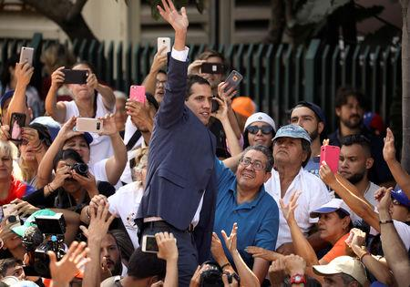 Venezuelan opposition leader and self-proclaimed interim president Juan Guaido waves to supporters at a rally against Venezuelan President Nicolas Maduro's government in Caracas, Venezuela February 2, 2019. REUTERS/Andres Martinez Casares