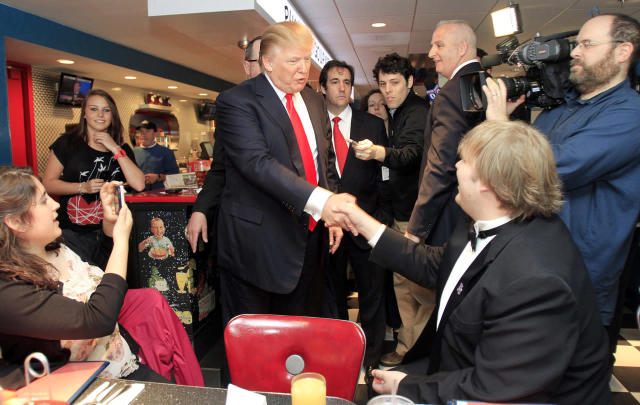 <p>Trump greets patrons during a stop at the Roundabout Diner, April 27, 2011, in Portsmouth, N.H. <i>(Photo: Jim Cole/AP)</i> </p>