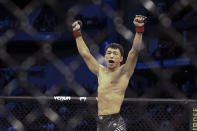 Danaa Batgerel celebrates his win of a UFC 261 mixed martial arts bout, Saturday, April 24, 2021, in Jacksonville, Fla. It is the first UFC event since the onset of the COVID-19 pandemic to feature a full crowd in attendance. (AP Photo/Gary McCullough)