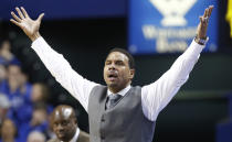 Providence head coach Ed Cooley questions a call during the second half of an NCAA college basketball game against Kentucky, Sunday, Nov. 30, 2014, in Lexington, Ky. Kentucky won 58-38. (AP Photo/James Crisp)