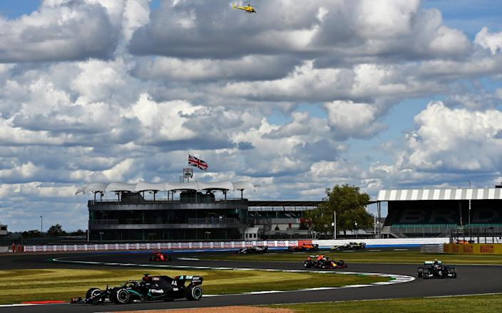 Lewis Hamilton of Great Britain driving the (44) Mercedes AMG Petronas F1 Team Mercedes W11 leads Valtteri Bottas of Finland driving the (77) Mercedes AMG Petronas F1 Team Mercedes W11 during the F1 Grand Prix of Great Britain at Silverstone - Clive Mason/Formula 1
