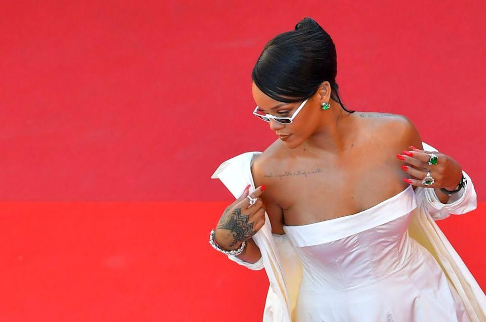 """<p>Since she burst onto the scene with 'Pon De Replay' and her first album Music Of The Sun in 2009, we've looked to <a href=""""https://www.elle.com/uk/fashion/celebrity-style/articles/g16505/rihanna-s-style-file/"""" rel=""""nofollow noopener"""" target=""""_blank"""" data-ylk=""""slk:Rihanna"""" class=""""link rapid-noclick-resp"""">Rihanna</a> as the inspiration for many things over the years.</p><p>She's encouraged us to address our feelings with moving songs like 'Stay', be creative when it comes to style (need we mention her <a href=""""https://www.elle.com/uk/fashion/celebrity-style/a33478696/rihanna-scared-met-gala-gown-2015/"""" rel=""""nofollow noopener"""" target=""""_blank"""" data-ylk=""""slk:showstopping Met Gala looks"""" class=""""link rapid-noclick-resp"""">showstopping Met Gala looks</a>?), take risks in beauty - <a href=""""https://www.elle.com/uk/beauty/hair/g9246/rihanna-hairstyles/"""" rel=""""nofollow noopener"""" target=""""_blank"""" data-ylk=""""slk:this was the woman who pulled off a mullet, guys"""" class=""""link rapid-noclick-resp"""">this was the woman who pulled off a mullet, guys </a>-, taught us the importance of standing up for social justice and being charitable, <a href=""""https://www.elle.com/uk/life-and-culture/g30036571/rihanna-sport-football-basketball-cricket/"""" rel=""""nofollow noopener"""" target=""""_blank"""" data-ylk=""""slk:living life to the full by always having fun"""" class=""""link rapid-noclick-resp"""">living life to the full by always having fun</a> and generally employing a 'no f*cks given attitude in life', like the time she took a hip flask to the Grammys or the constant clap backs to <a href=""""https://www.elle.com/uk/life-and-culture/culture/a30313672/rihanna-new-music-update/"""" rel=""""nofollow noopener"""" target=""""_blank"""" data-ylk=""""slk:impatient fans badgering for her ninth album."""" class=""""link rapid-noclick-resp"""">impatient fans badgering for her ninth album.</a></p><p>Last but not least, Rihanna is looked to for <a href=""""https://www.elle.com/uk/fashion/trends/g15723/celebrity-tattoos/"""" rel=""""nofollow noopener"""" target=""""_blank"""" d"""