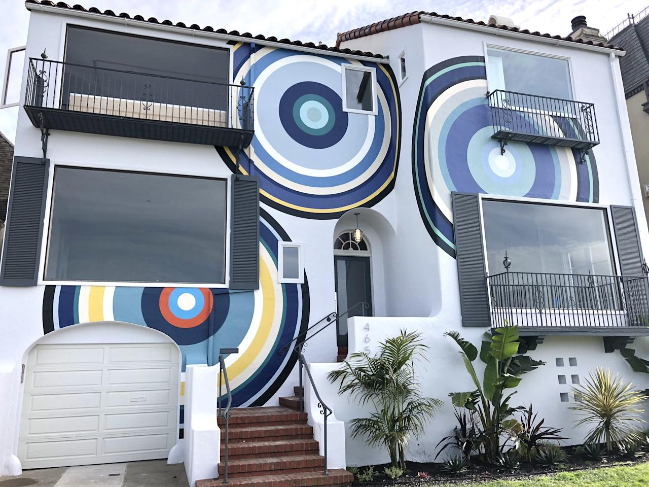 You can't miss it, even if you try. The home's façade was designed by Simon Breitbard Fine Arts resident artist (pun intended) AJ Oishi. In essence a large-scale mural painting spread across the house, the work provokes both contemplation and conversation with its three oversize swirling bullseyes.
