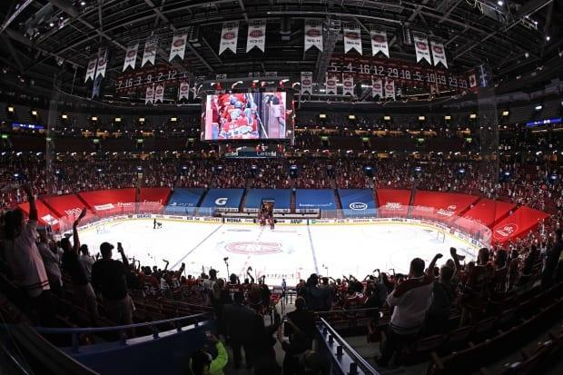 Fans at the Bell Centre celebrating the Montreal Canadiens series win against Winnipeg Jets last week. Attendance at the arena is currently capped at 2,500.  (Jean-Yves Ahern/USA TODAY Sports - image credit)