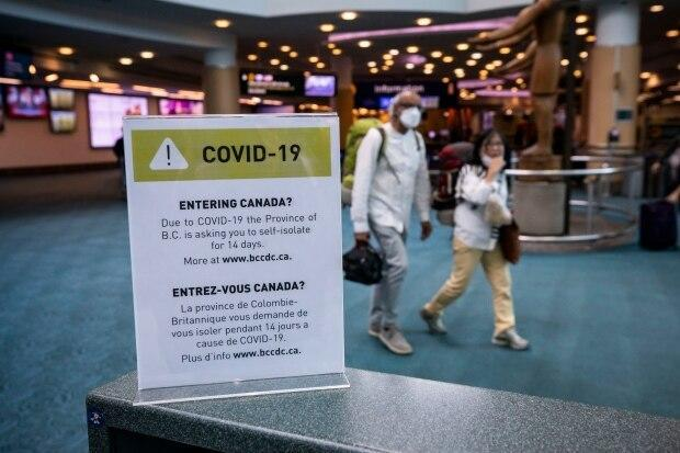 Passengers walk through the international arrivals section at Vancouver International Airport. Some international students say they have to overcome big hurdles to arrive in Canada for school. (Ben Nelms/CBC - image credit)