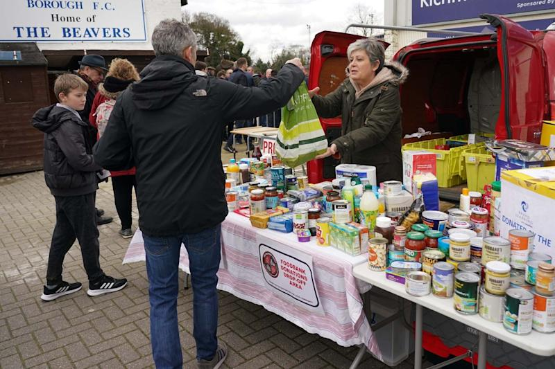 Football fans donate to a food bank in London: BPI/Rex