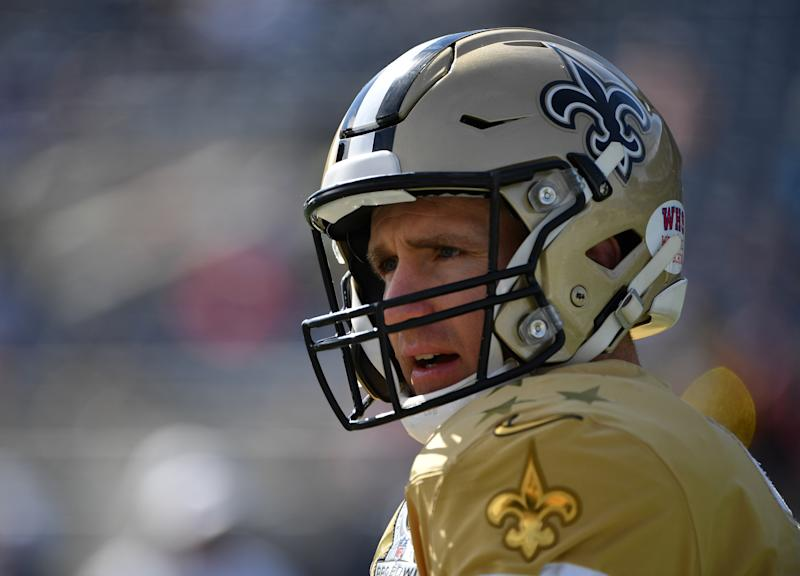 Drew Brees looks ahead during warmups for the Pro Bowl while wearing a gold Saints helmet and jersey.