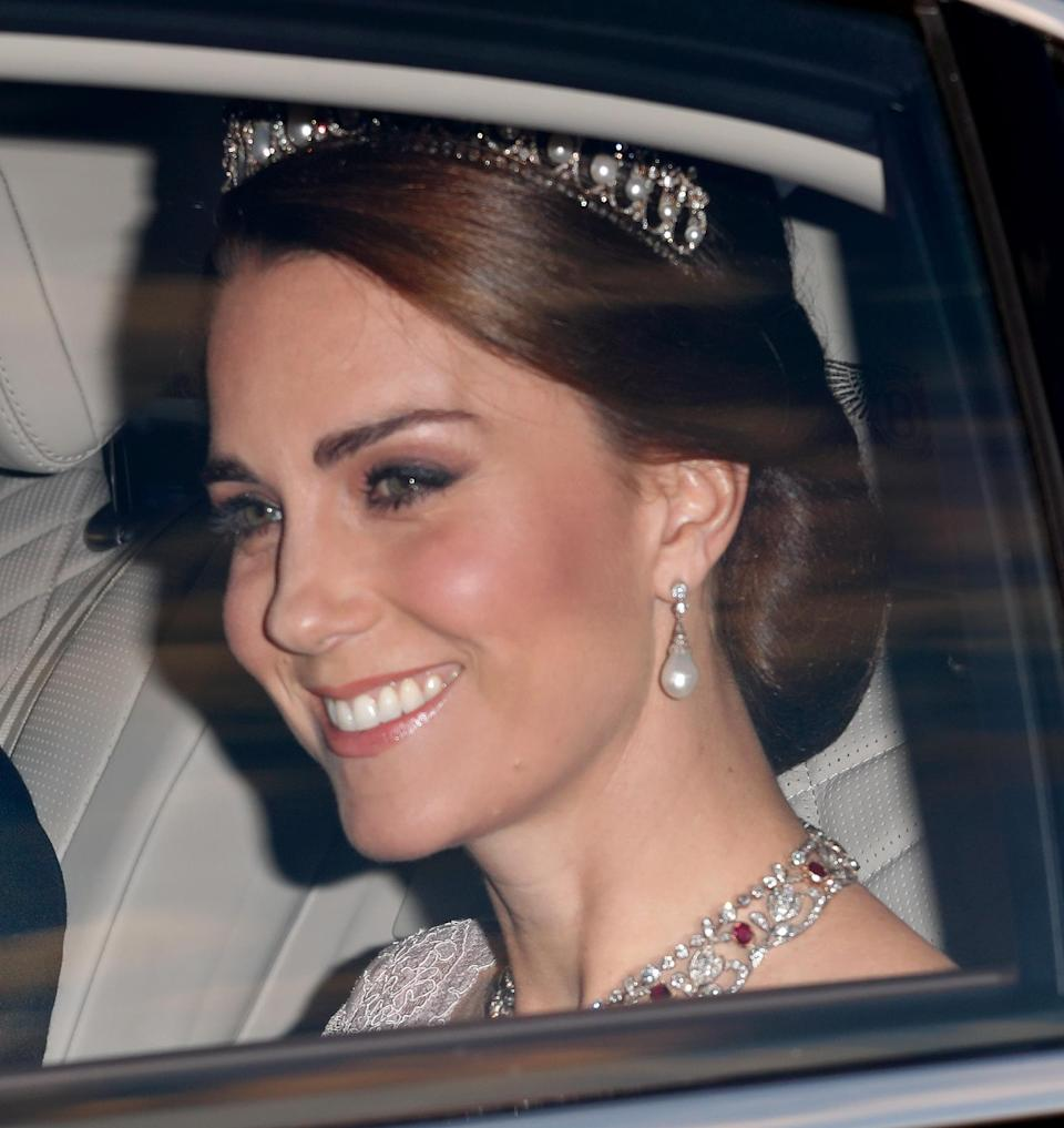 Kate wore the Lover's Knot tiara for the third time, with a lace pink Marchesa gown for the Spain State Dinner in 2017. The Duchess also borrowed the Queen's Ruby and Diamond Floral Bandeau Necklace for the occasion (Getty)