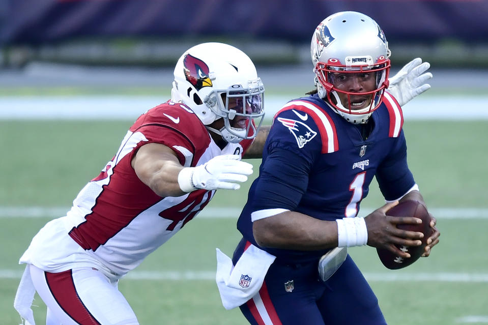 Arizona's Isaiah Simmons hit Cam Newton hard on the last drive, and the ensuing penalty helped the Patriots win. (Photo by Billie Weiss/Getty Images)