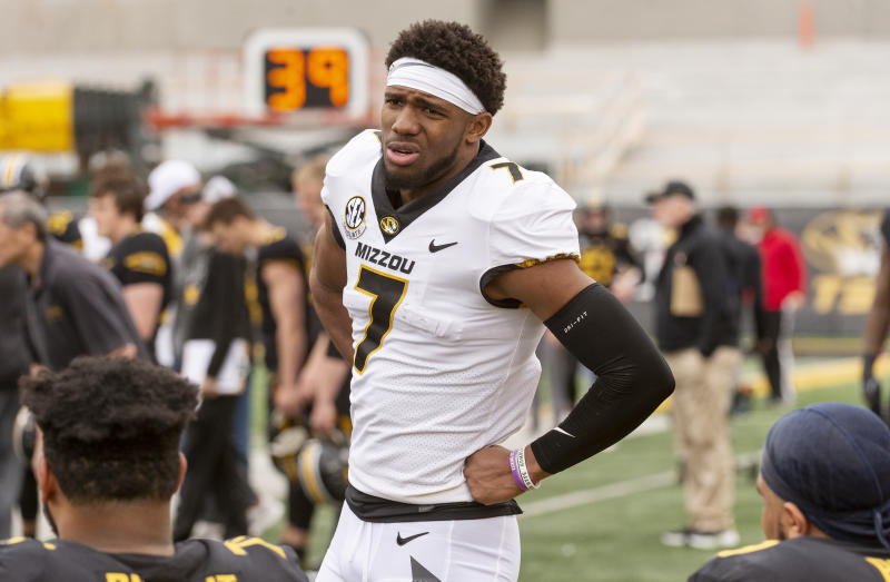 Missouri quarterback Kelly Bryant talks with teammates on the bench during an NCAA college football intra-squad spring game Saturday, April 13, 2019, in Columbia, Mo. (AP Photo/L.G. Patterson)