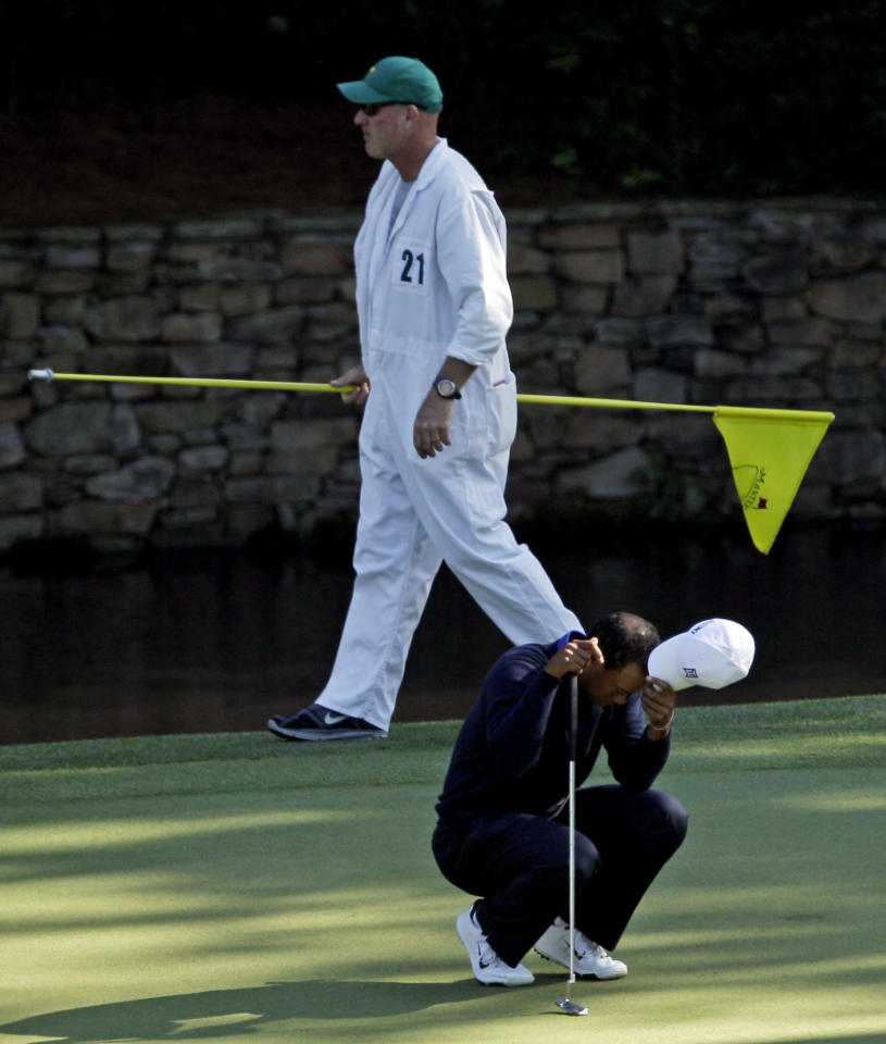 Tiger Woods reacts after missing a putt for a bogie on the 11th hole during the second round of the Masters golf tournament Friday, April 6, 2012, in Augusta, Ga. (AP Photo/Matt Slocum)