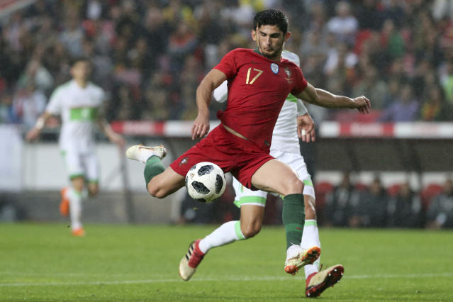 Portugal's Goncalo Guedes attempts a shot on goal during a friendly soccer match between Portugal and Algeria in Lisbon, Portugal, Thursday, June 7, 2018. (AP Photo/Armando Franca)