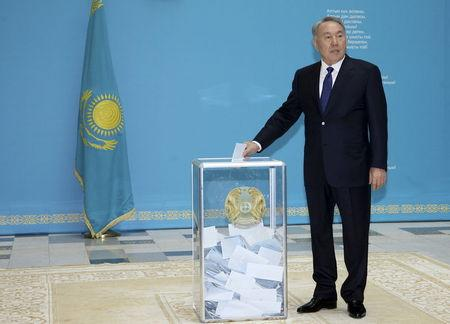 Kazakhstan's President and presidential candidate Nazarbayev casts ballot during snap presidential election in Astana