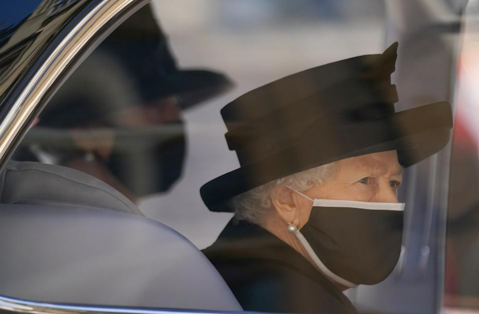 Britain's Queen Elizabeth II arrives for the funeral of Britain's Prince Philip, who died at the age of 99, at St George's Chapel, in Windsor, Britain, April 17, 2021. Victoria Jones/Pool via REUTERS