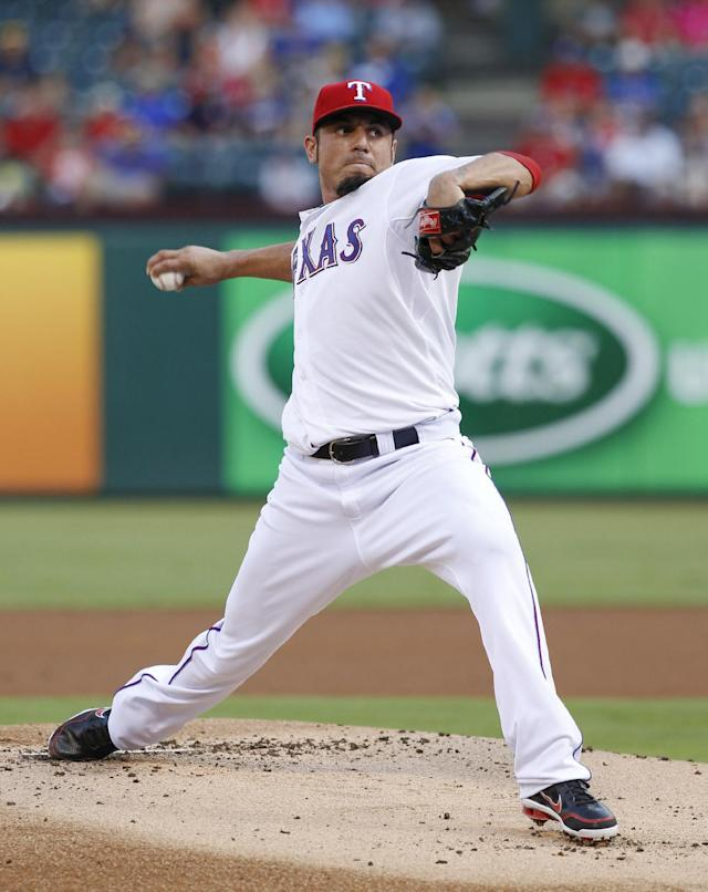 Texas Rangers starting pitcher Matt Garza throws to the New York Yankees during the first inning of a baseball game, Wednesday, July 24, 2013, in Arlington, Texas. (AP Photo/Jim Cowsert)