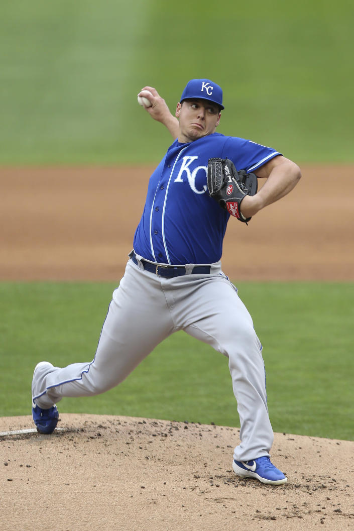 Kansas City Royals' pitcher Brad Keller throws against the Minnesota Twins during the first inning of a baseball game, Sunday, May30, 2021, in Minneapolis. (AP Photo/Stacy Bengs)