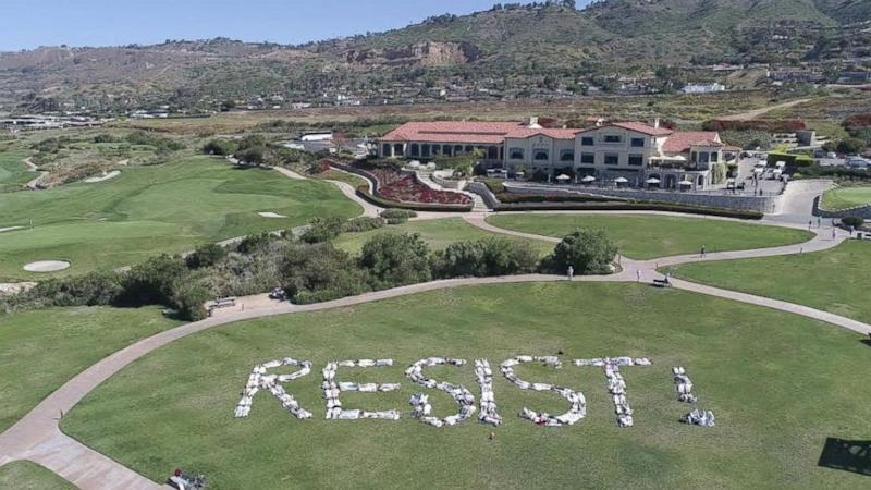 Donald Trump protesters spell out 'Resist!' at golf course
